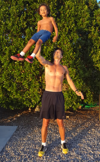 Roger Lifts His Son Andrew Over his Head with 1 Hand